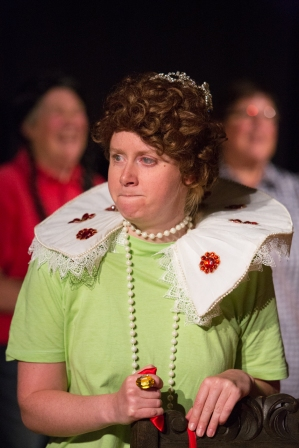 Elizabeth I in ruff, red wig and pearl necklace over her green chorus t shirt
